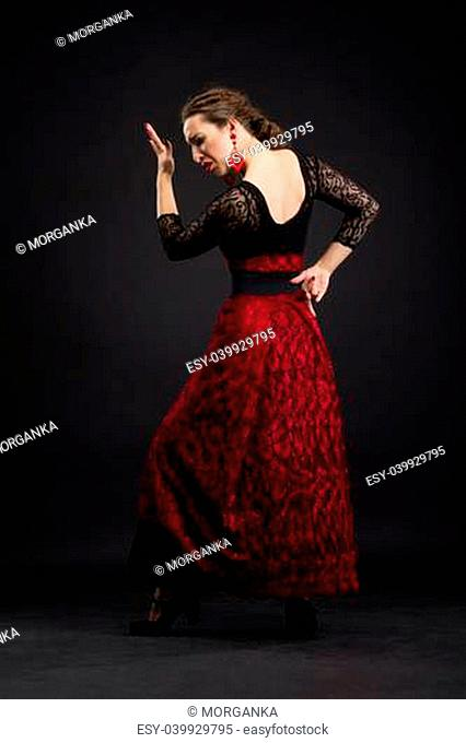Flamenco dancer in black and red dress with red earrings