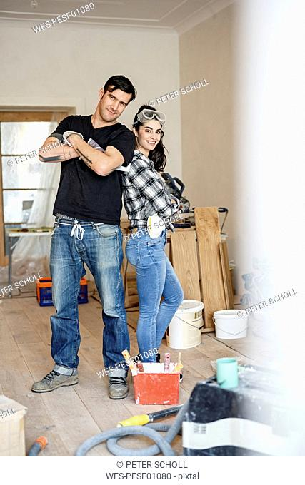 Happy couple renovating their new home