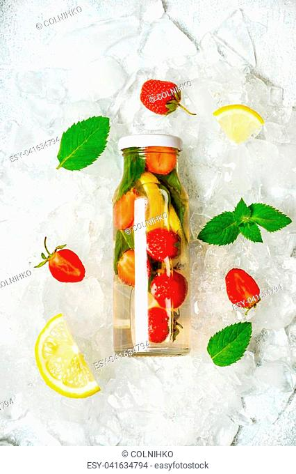 Strawberry lemon lemonade and ingredients. Lemon, berries and mint