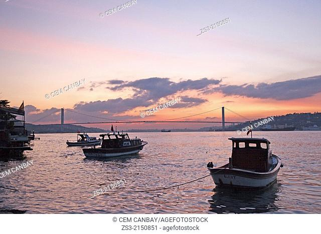 Fishing boats at sunset with the bridge in the background on Bosphorus, Marmara Region, Istanbul, Turkey, Europe