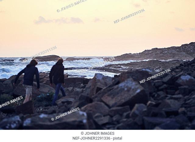 Couple walking at sea