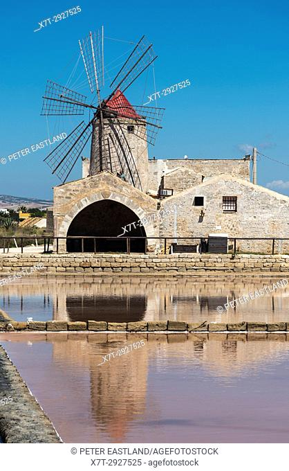 windmills and saltpans at the Museum of salt, near Nubia, south of Trapani, on the west coast of Sicily, Italy