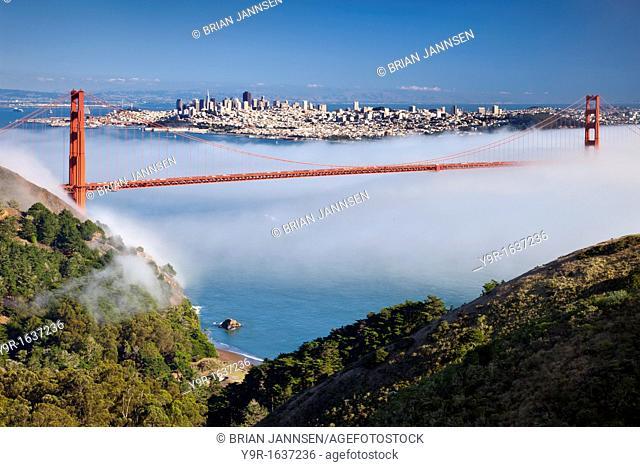 Afternoon fog rolls under the Golden Gate Bridge into San Francisco Bay, California, USA