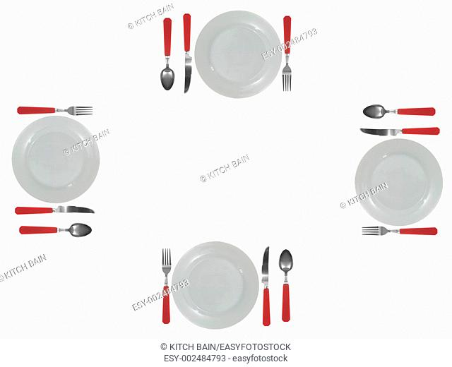 A dinner setting with cutlery and plates