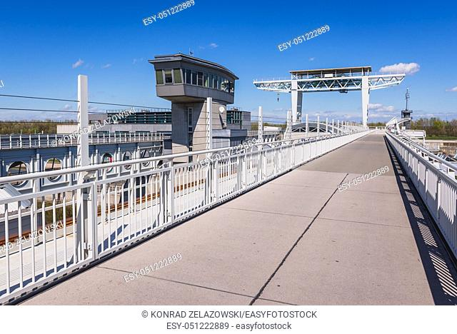 Bicycle and pedestrian path on Freudenau run of the river hydropower plant on a Danube River in Vienna, Austria