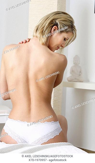 woman, back, blond,blonde, hair, underwear, bed,indoor,beauty,wellness,sense well-being,skin,neck,backache