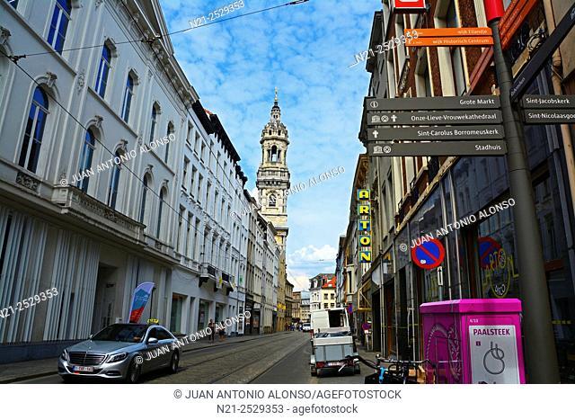 Street leading to Sint Carolus Borromeuskerk, whose tower is seen in the background. Antwerp, Belgium, Europe