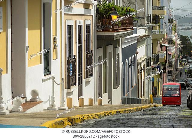 COBBLESTONE STREET COLORFUL PAINTED BUILDINGS CALLE DE LA CRUZ OLD SAN JUAN PUERTO RICO