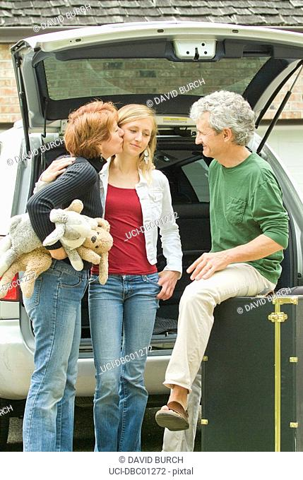 Parents helping daughter load belongings for college