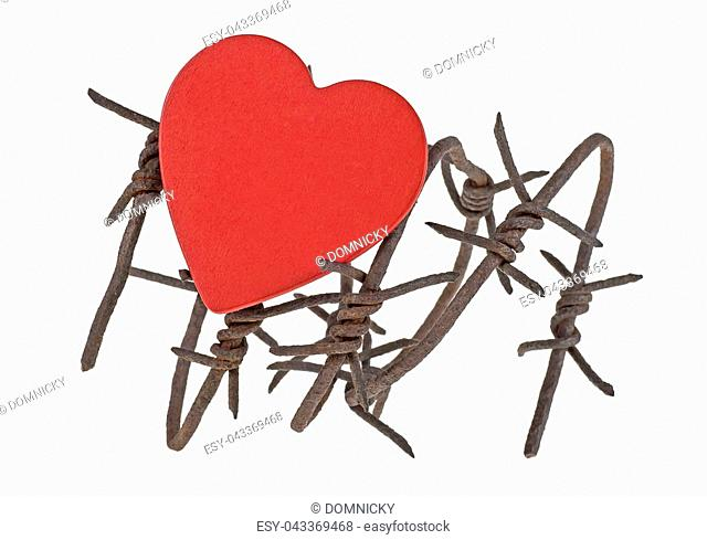 Red wooden heart is hung on the barbed wire, white background