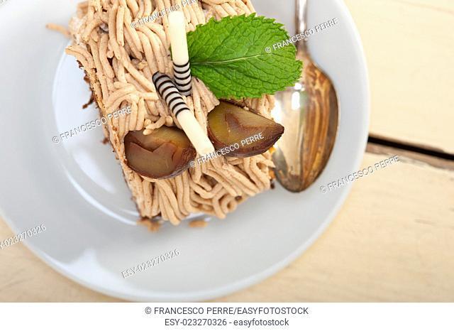 fresh baked chestnut cream cake dessert over rustic white wood table