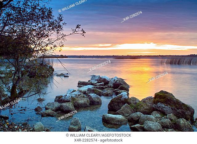 Rock shoreline of Lough Ennell at sunset, Tudenham, near Mullingar, County Westmeath, Ireland