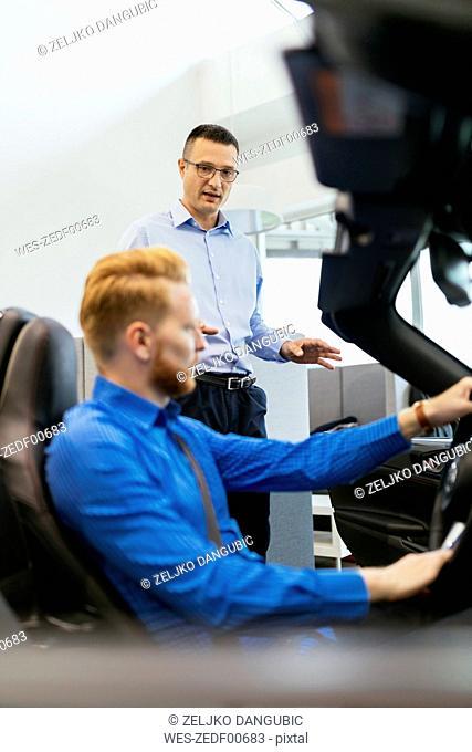 Customer in car dealership testing car