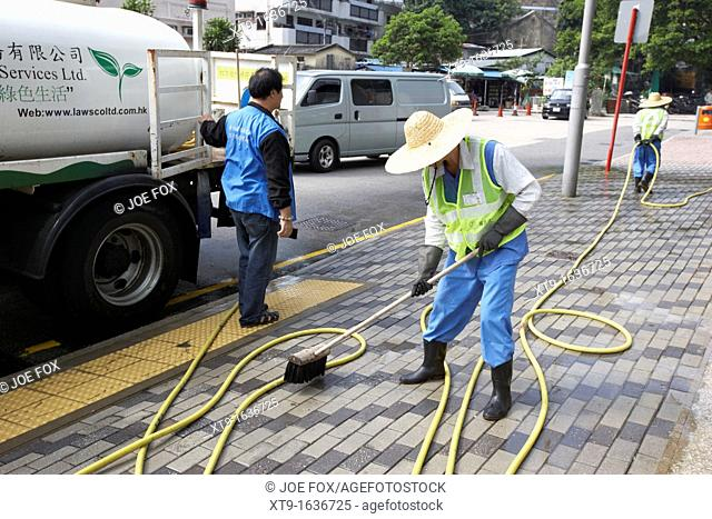 chinese workers cleaning washing pavement in sha tin new territories hong kong hksar china asia