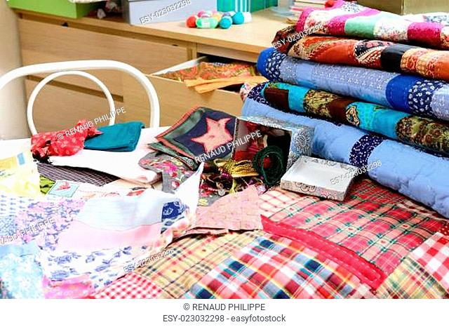 workshop of a seamstress with fabric and quilting