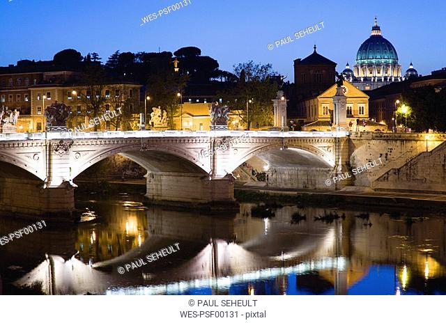 Italy, Rome, Vatican City, Basilica Saint Peter at night, seen from Ponte Vittorio Emmanuele