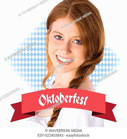 Composite image of oktoberfest girl smiling at camera