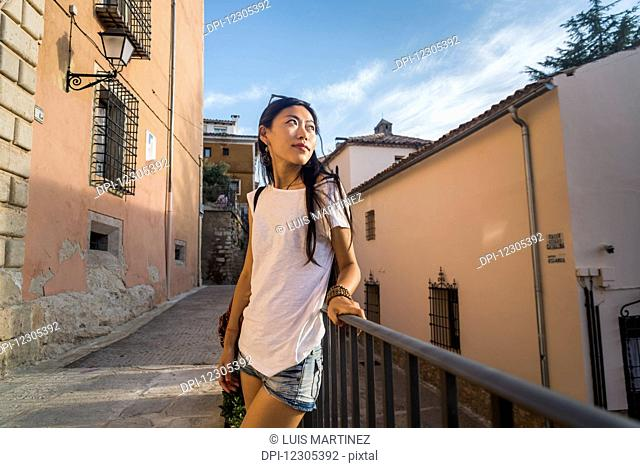 A young Chinese woman in downtown Cuenca; Cuenca, Castile-La Mancha, Spain
