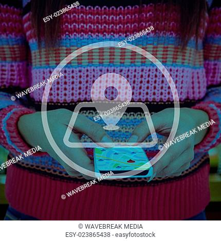 Composite image of mid section of a hipster woman using her smartphone