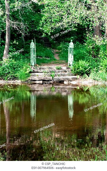 stone steps leading in water lake in the Park