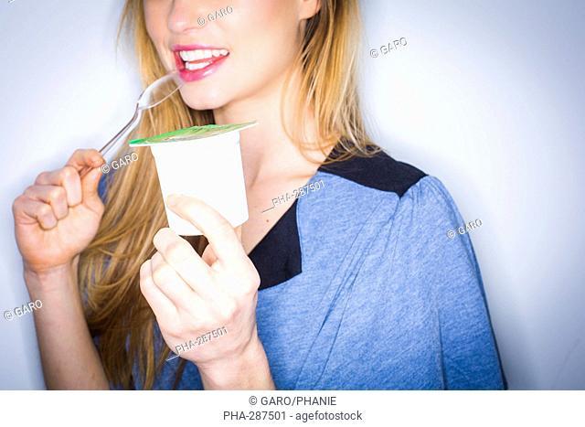 Woman eating yogourt
