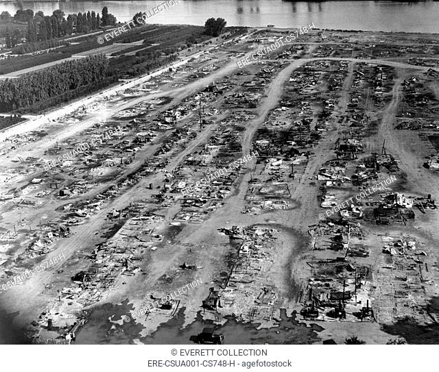The bulldozed and smoking remains of the Bonus Army Encampment at Anacostia Flats in Washington, DC. July 29, 1932. CSU-ALPHA-1780 CSU Archives/Everett...