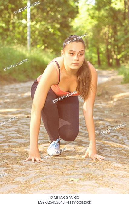 Fitness Healthy Young Woman ready for Running Outdoor . Portrait of caucasian brunette female healthcare lifestyle