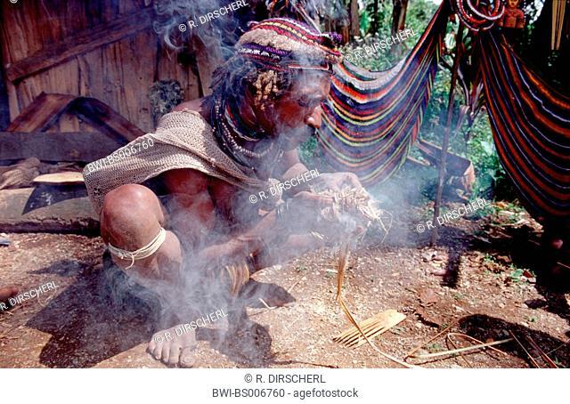 Huli makes fire, Papua New Guinea, Tari