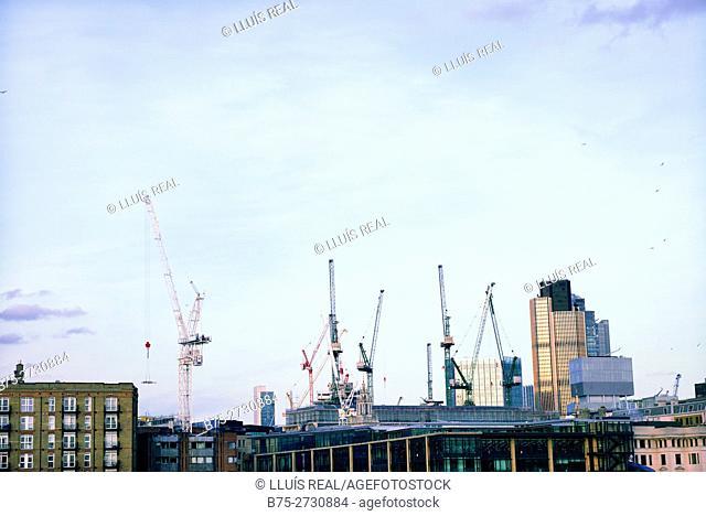 City of London skyline with construction cranes. London, England