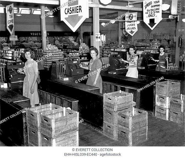 Four cash registers at a new supermarket, Tulip Town Market, 1945 in Oak Ridge, Tennessee. - (BSLOC-2015-1-163)