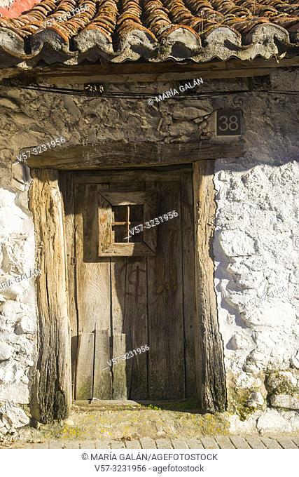 Old wooden door. rascafria, Madrid province, Spain