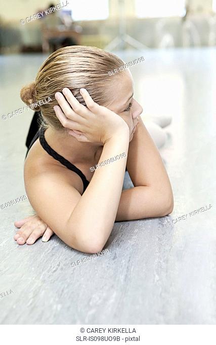Ballerina resting on floor
