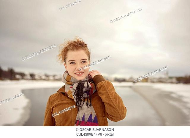 Portrait of woman outdoors, smiling