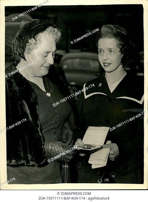 Nov. 11, 1957 - The 'Angel of Mercy' Receive the OBS.She Helped Many Displayed Persons - Among the Many persons received awards from RH The Quees at today as...