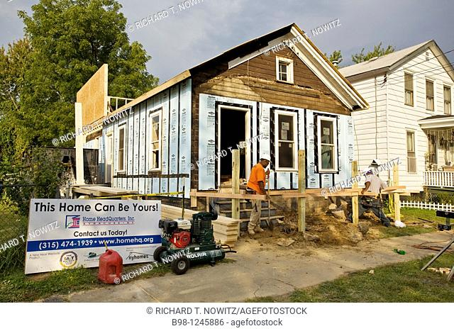 Home Headquarters, construction workers remodel old housing stock into new green energy efficient housing units  Work crew is employed by Home Headquarters...