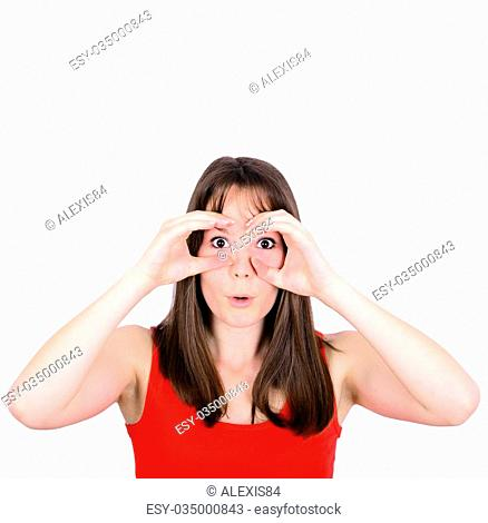 Portrait of young woman looking through imaginary binoculars isolated on white