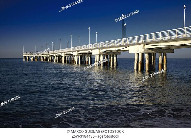 View of the white pier of Marina di Massa Tuscany Italy