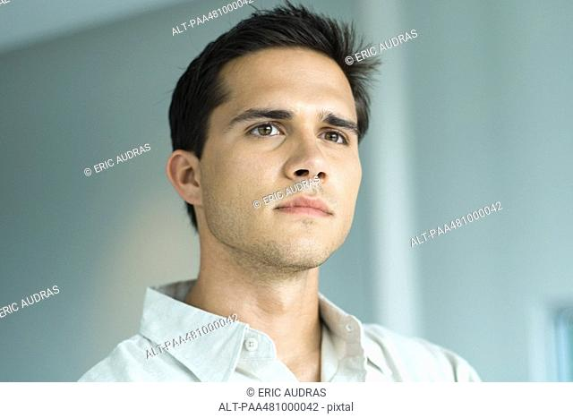 Young man looking away, portrait