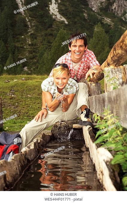 Austria, Salzburger Land, couple drinking water