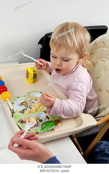 CHILD EATING A MEAL Models