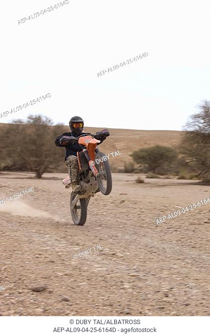 Photograph of motorcycle race in the Negev desert