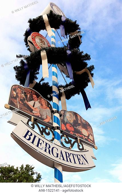 traditional maypole and beer garden sign, Germany
