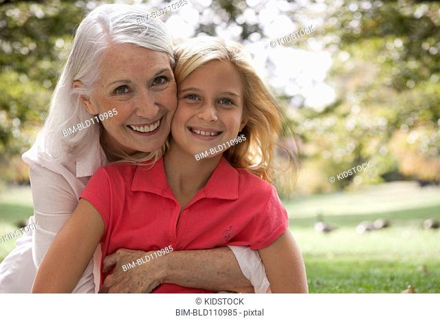 Woman hugging granddaughter