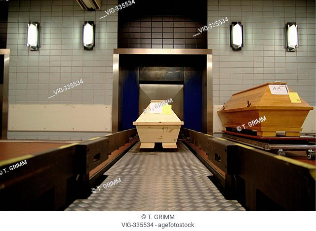 Cremation in Hamburg crematorium on the cemetery Hamburg Oejendorf. The picture shows coffins in front of the automatical entrance to the burner with about 1000...