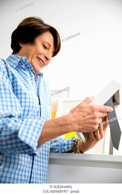 Senior woman looking at picture frame