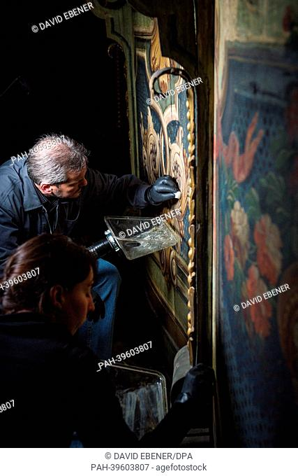 Restorers work on paintings on the ceiling of the Margravial Opera House in Bayreuth,Germany, 17 May 2013. Anew information center is hoping to make it easier...