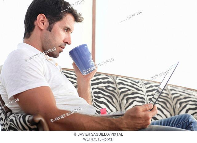 Man using laptop computer at home