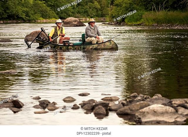 Bass Fishermen In Canoe In A River