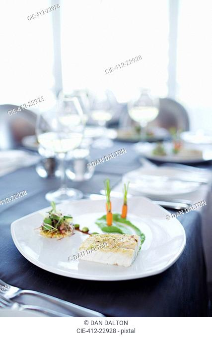 Fancy fish meal on plate in restaurant