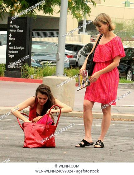 Actresses Alicia Arden and Rena Riffel stop in a parking lot to try new skin lotions bought during their shopping trip to Westfield Topanga in Canoga Park...